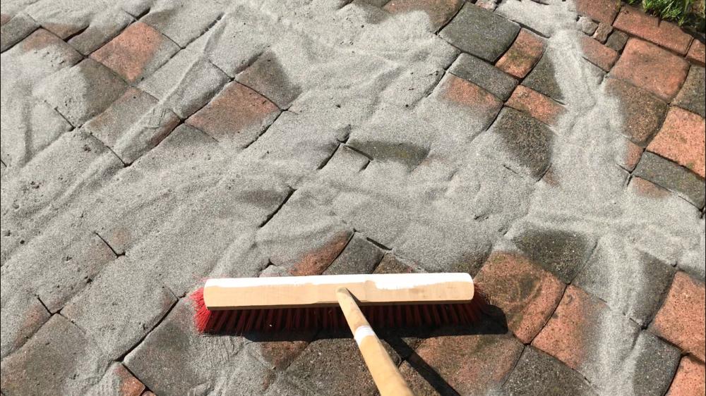 DANSAND auf Terrasse verteilen